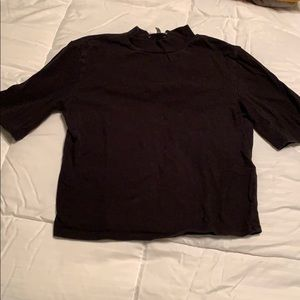 A black turtleneck shortsleeved crop top